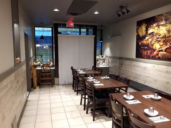 Lovely additional room for additional customers and patrons as well as the washrooms are located at the far end of this dining area.