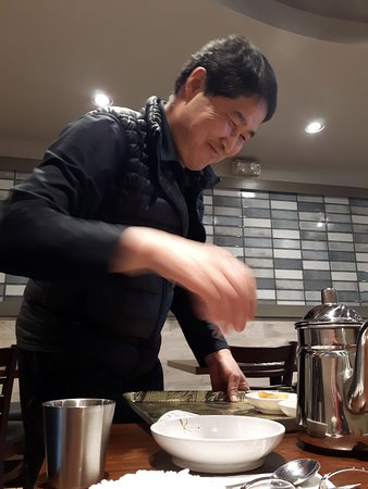 """Here, our server is re-filling our """"banchan"""" or side dishes!"""
