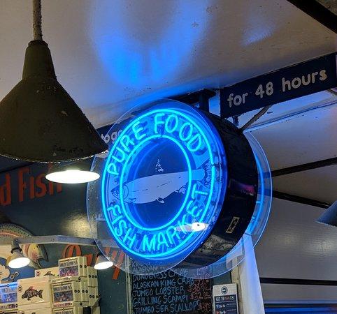 Pure Fish Market neon sign.