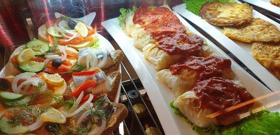 Sandwiches with fish (salmon, herring), cabbage rolls, potato pancakes