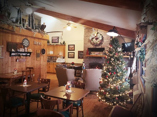 Cold Spring, MN: Our lodge-like lobby with its warm and inviting fireplace at Christmas.