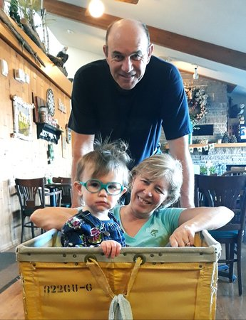 Cold Spring, MN: We also know how to have a bit of fun! Here owners Jim & Ann DeRose play with granddaughter Quinn - taking her for a spin in the laundry cart!