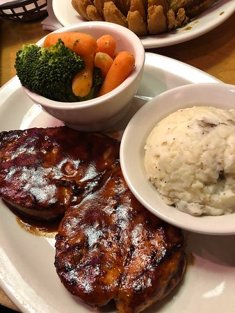 Roseville, MI: The Grilled BBQ Chicken paired with two sides including mashed potatoes and mixed vegetables.