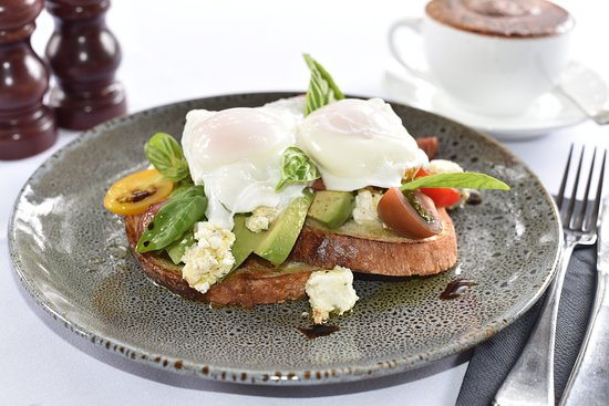 Avocado, marinated feta, poached egg, balsamic olive oil and roasted tomatoes on crusty bread