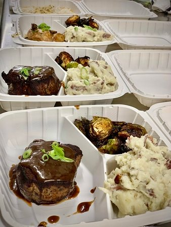 Brooksville, Мэн: Fine dining to go—curbside or takeout only during these uncertain times. Beef tenderloin with Demi glacé, garlic mashed potatoes and roasted Brussels sprouts.