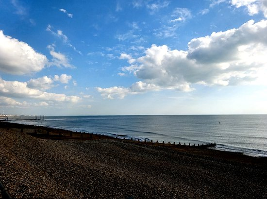 Southwick, UK: The beach is less than a stones throw from the cafe - that is Brighton in the distance.