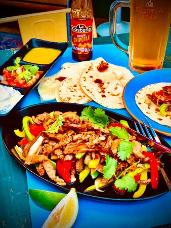 Fajitas with salsa Chipole and a cold beer!
