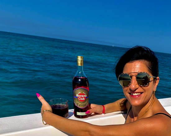 My wife enjoying a local drink while I was out snorkeling