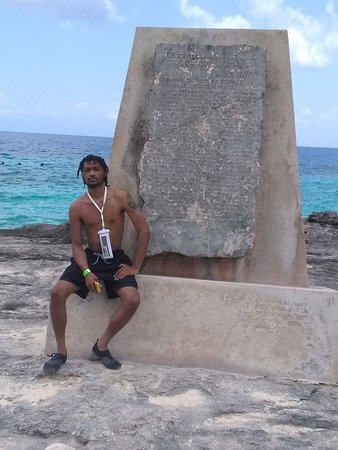 My son sitting in front on a statue off the island