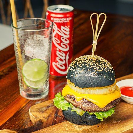 Squid-ink beef burger with fries