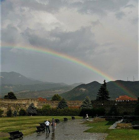 "A rainbow over ""Svetitskhoveli Cathedral"" in Mtskheta."