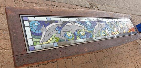 Largs Bay Jetty SA  mosaic seat at the front of the jetty facing the walkway