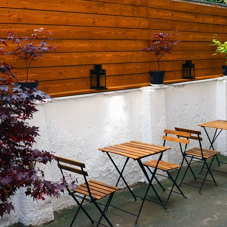 Garden burger restaurant - inside terrace. Calm chill burgrers and beer chill and wine coffee and shadow good mood and great day 🙂