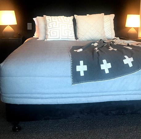 Extra large King beds in each bedroom with designer pillows throws and hot water bottles for those chilly nights