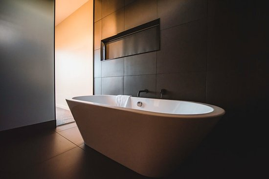 Enjoy the designer tiled bathroom with free standing bath. Lie back and soak it in, there is a view of the lake and stars even from the bath!!