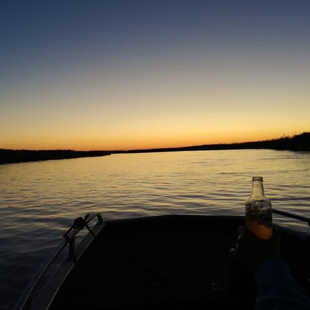 Shakawe River Sunsets on the boat... a cold cider to complete that. 🤎🇧🇼  #iammalebogobusang  #shakawe #botswanatravel #iamqfrican