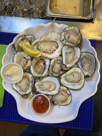 1 dozen freshly shucked oysters. 1/2 dozen $9.99/1 dozen $16.99