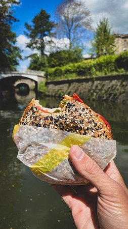 One of our customers enjoying our bagels on a sunny day along the canal.