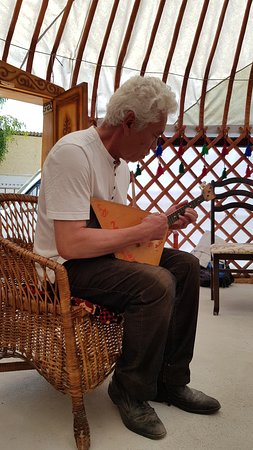 Owner playing a traditional instrument
