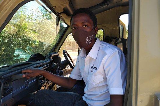 Iringa Region, Tanzania: Tour Briefing completed -  boarding tourist Safari jeep ready to take-off