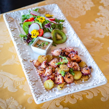 Grilled Octopus. Tossed with oven roasted baby potatoes, white wine and fragrant herbs
