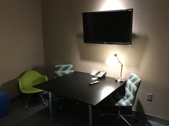 """""""Office' area in the suite with funky furniture and large screen TV"""
