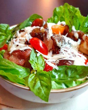 A&T's ceasar salad. With chicken, cherry tomatoes, croutons, bacon, roman lettuce & ceasar dressing.