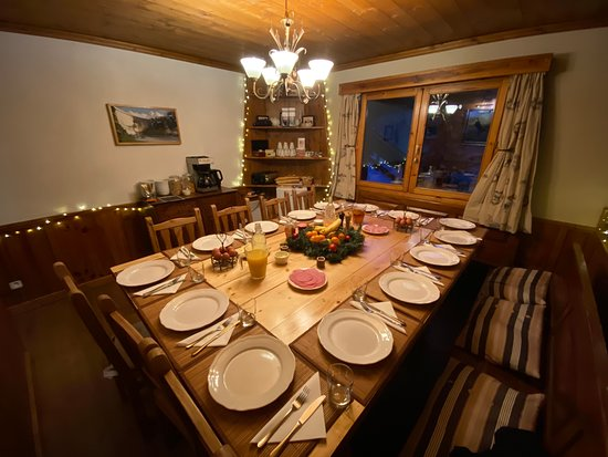 Chalet Patineur large dining table sits 14. A great space to enjoy our breakfasts and 3 course nightly dinners. Sit and enjoy some after dinner entertainment with our free wine!