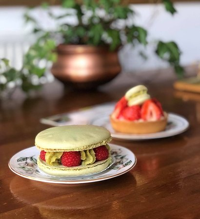 Front : Pistachio and Raspberry Macaroon - Back : Fresh Strawberry Tart with Creme Patissiere, served on a homemade, pure butter short crust pastry and frangipane base.