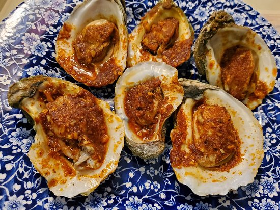 Steamed oysters and clams & mussels seafood boil. All with the special Mr. & Mrs. Crab sauce at a mild spice level. Nice kick of heat!