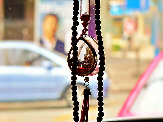 Taking a taxi in Bangkok, this amulet was hanging on the driver's mirror 🙏🙏🙏