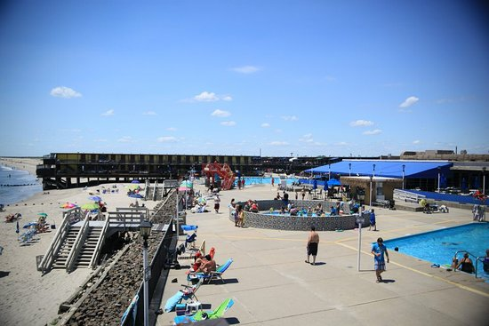 Breezy Point, NY: Silver Gull Beach Club offers family-friendly amenities such as a kiddie pool with a water feature and a family pool with a water slide.