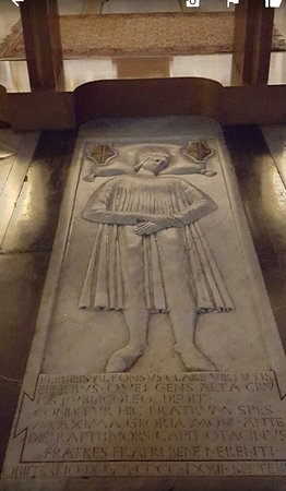 Tomb-slab in the floor : this one to Alfonso Santacroce, the restorer of the church, dates from 1472 and shows his effigy in shallow relief.
