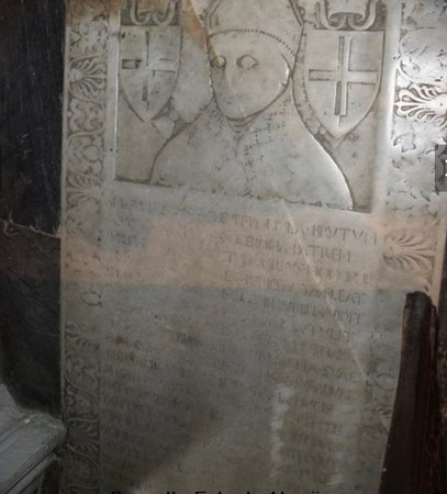 The tomb-slab of Angelo Tucci, a canon of St Peter's, 1435.