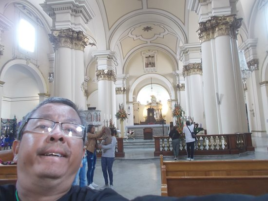 """Near the far end of the Cathedral with the altar seen behind me (in the """"main part"""" of the Cathedral)"""