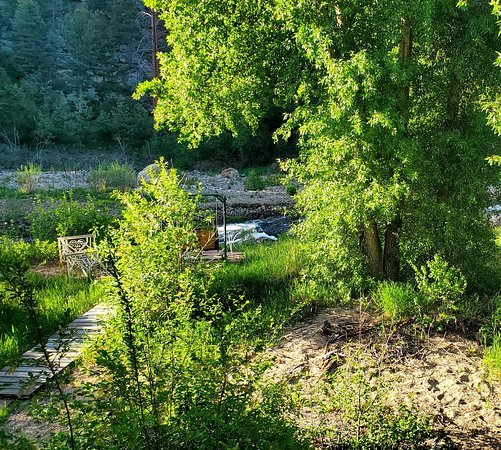 Drake, CO: This photo is taken from our balcony.  The swings on the shore of the river provide a peace you won't find very often!