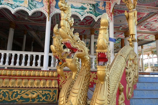 The dragon figures flanking either side of the steps to the entrance to the Pavilion building.