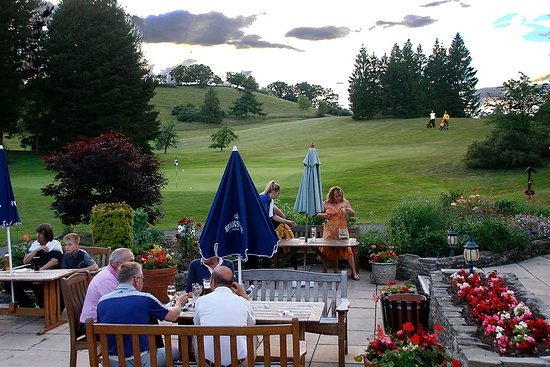Members Enjoying Refreshments on the Patio, which overlooks the 18 Green at Bridgnorth Golf Club,  The Best Golf Course in Shropshire