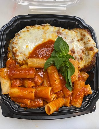 Chicken Parmigiana - Lightly breaded chicken breast topped with melted Mozzarella cheese and homemade Marinara sauce. Served with a side of Rigatoni Marinas, bread and dipping sauce.