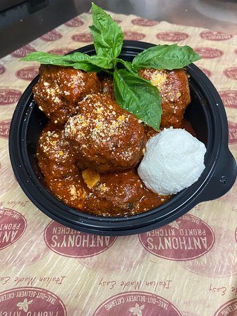 Anthony's Homemade Meatballs - Hand-Rolled Beef Meatballs. Slow-Cooked in Homemade Meat Sauce. Served with Ricotta Cheese.