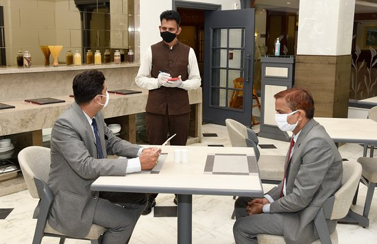 guest order taking in restaurant with social distance
