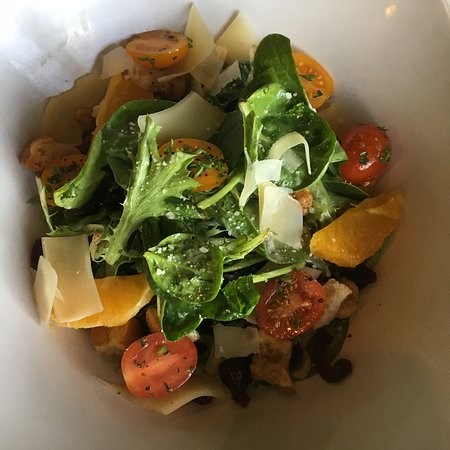 Summer Salad - mixed greens, tomatoes, oranges, candied walnuts and sundried cranberries, tossed in a citrus dressing.
