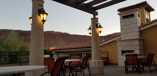 Unique roof top patio to enjoy sunset over Moab Rim.