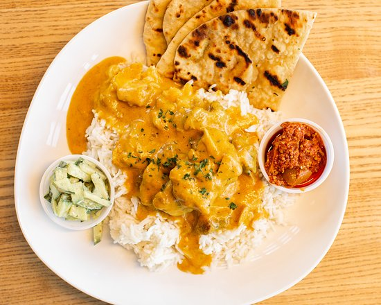 Indonesian Chicken Curry: Spicy coconut chicken curry with basmati rice, chutney, pickled mint cucumber and naan bread.