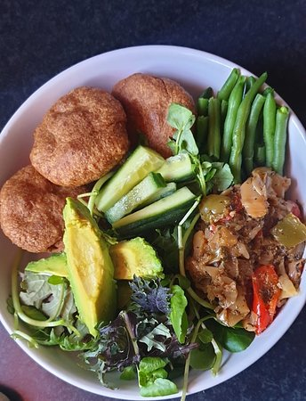 Hillingdon, UK: plant based bowl of goodness fried spelt bakes with green beans, avocado, cabbage onion and garlic stew with loads of Caribbean flavours and a nice hearty side salad