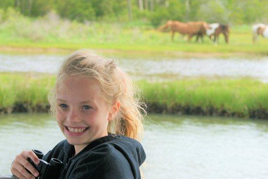 Granddaughter loving the wild ponies!