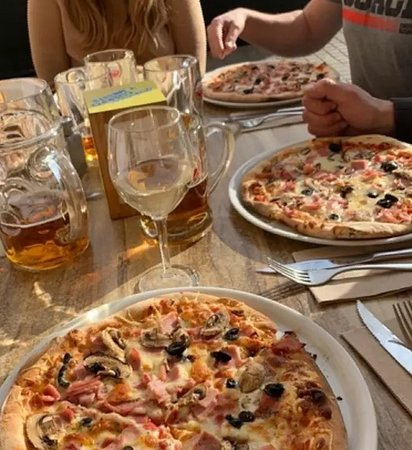 Paella Marinera,cocktail,arroz caldoso con bogavante,pizzas,bravas,crema catalana,calamar a la romana,