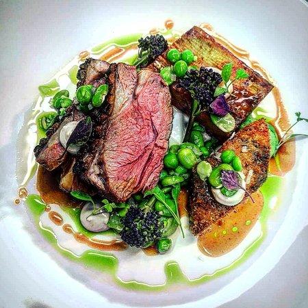 Rump of lamb, confit potato terrine, crispy belly, pea, broad bean, mint, anchovy