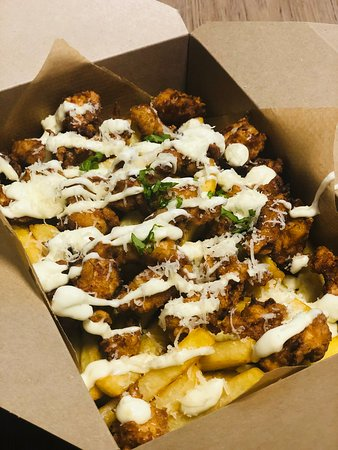 Buttermilk fried chicken, parmesan and garlic mayo loaded fries
