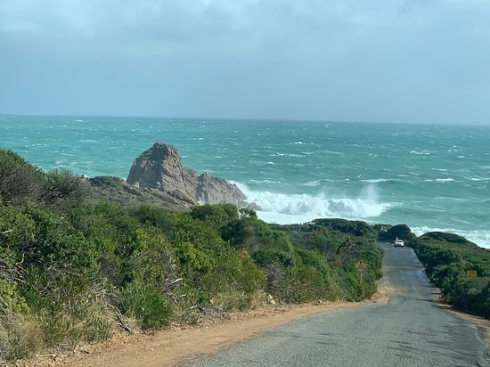 Sugarloaf Rock off Cape Natraliste Road, Dunsborough/Yallingup.  View driving down to the rock with the massive swell from a storm that day in May 2020.  Powerful waves at a magical piece of coastline